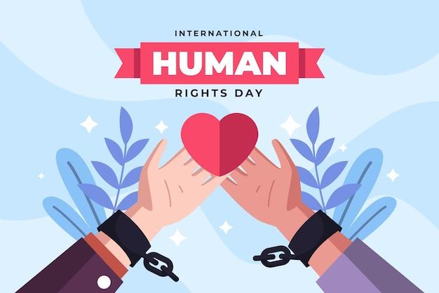 Illustration plate de la journée internationale des droits de l'homme avec les mains dans les poignets en chaîne brisée tenant le coeur