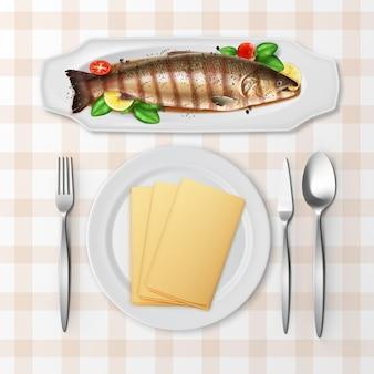 Illustration de poisson truite grillé servi avec tomates, basilic et citron en sauce sur un plateau blanc avec des couverts sur une nappe à carreaux, vue du dessus