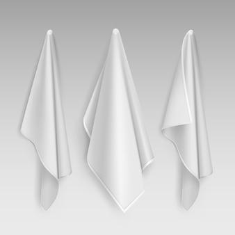 Illustration de suspendre trois serviettes en coton blanc et propre