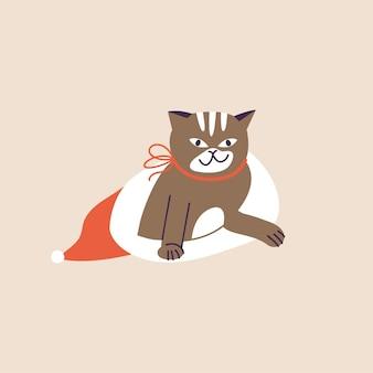 Illustration vectorielle chat de noël mignon à l'intérieur du chapeau de vacances rouge et avec un arc rouge. ambiance de vacances d'hiver.
