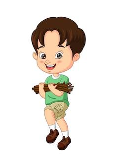 Illustration vectorielle de dessin animé petit garçon transportant du bois de chauffage