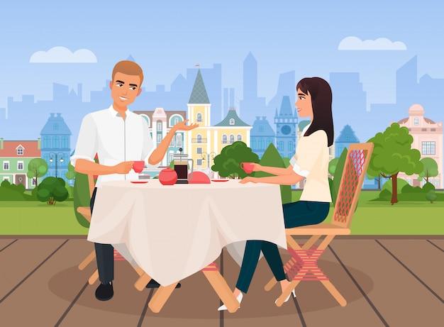 Illustration vectorielle de jeune homme et femme en communication assis dans un café extérieur sur le fond de la vieille ville.