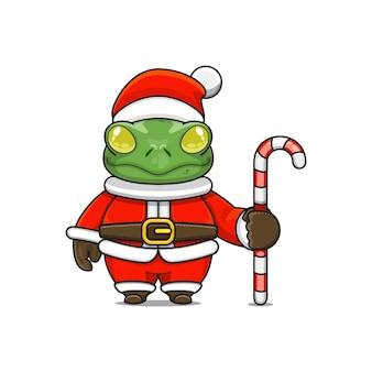 Illustration vectorielle de mascotte grenouille monstre mignon portant un costume de père noël tenant une canne en bonbon