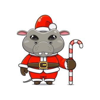 Illustration vectorielle de mascotte hippo monstre mignon portant un costume de père noël tenant une canne en bonbon