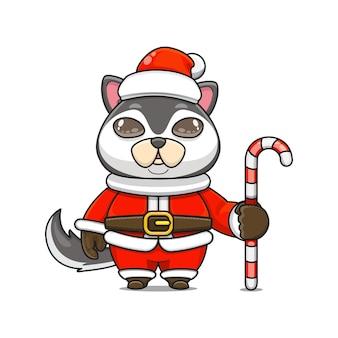 Illustration vectorielle de mascotte husky monstre mignon portant un costume de père noël tenant une canne en bonbon