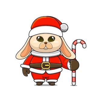 Illustration vectorielle de mascotte de lapin monstre mignon portant un costume de père noël tenant une canne en bonbon