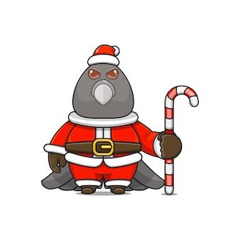 Illustration vectorielle de mascotte d'oiseau monstre mignon portant un costume de père noël tenant une canne en bonbon