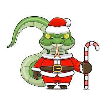 Illustration vectorielle de mascotte de reptile monstre mignon portant un costume de père noël tenant une canne en bonbon