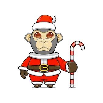 Illustration vectorielle de mascotte de singe monstre mignon portant un costume de père noël tenant une canne en bonbon