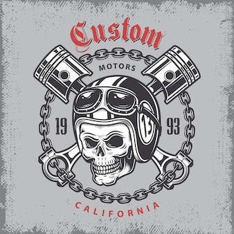 Impression de moto vintage avec crâne en casque de moto et pistons croisés sur fond de grange.