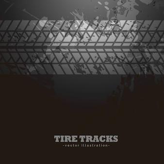 Impression des pistes de pneus sur fond sombre
