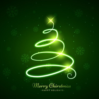 Incandescent arbre de Noël dans le fond vert