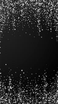 Incroyable fond de noël étoiles filantes. flocons de neige volants subtils et étoiles sur fond noir. modèle de superposition de flocon de neige argenté d'hiver séduisant. illustration verticale animée.