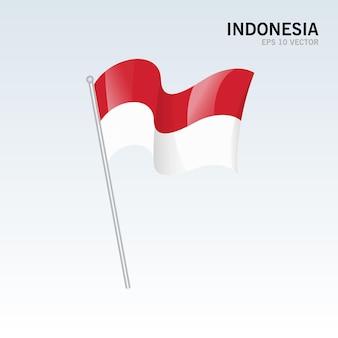 Indonésie, agitant le drapeau isolé sur gris