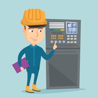 Ingénieur debout près du panneau de commande.