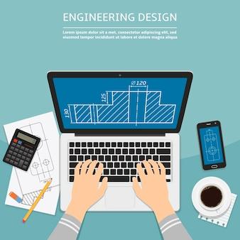 Ingénieur travaillant sur ordinateur portable avec plan à l'écran