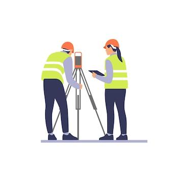 Ingénieurs géomètres avec équipement théodolite ou station de positionnement total sur le chantier