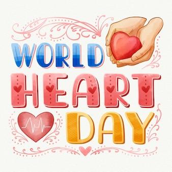 Inscription de la journée mondiale du coeur aquarelle avec coeur et mains