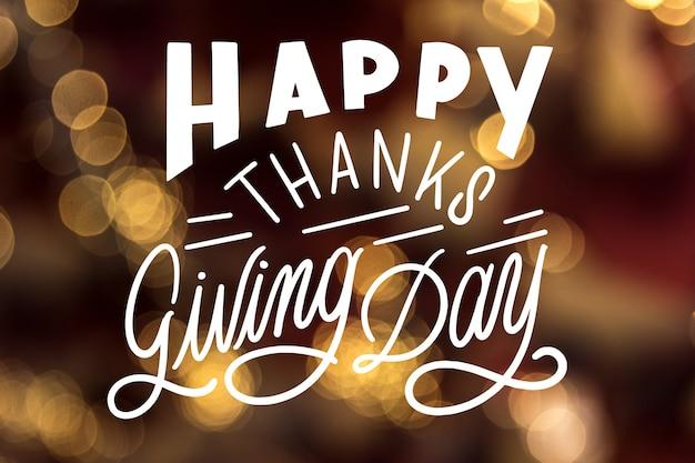 Inscription de joyeux thanksgiving sur fond flou