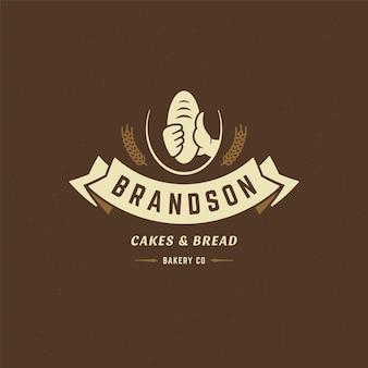 Insigne de boulangerie ou étiquette illustration vectorielle rétro main tenant la silhouette du pain ou du pain pour le fournil