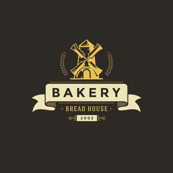 Insigne de boulangerie ou étiquette rétro vector illustration moulin silhouette pour fournil
