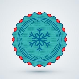 Insigne de flocon de neige de noël
