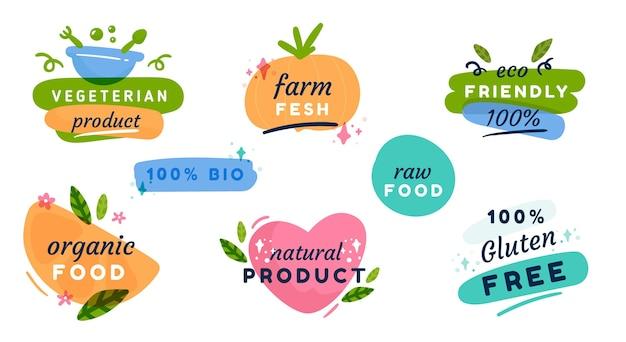 Insignes et étiquettes de nourriture végétarienne design plat dessinés à la main