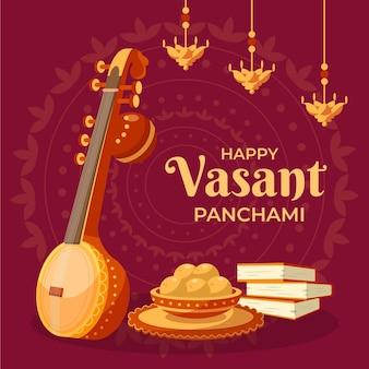 Instrument de guitare doré et nourriture vasant panchami