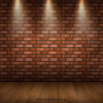 Intérieur de la chambre avec parquet et mur de briques