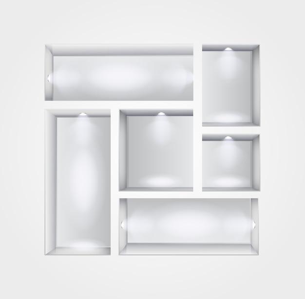 Intérieur de la galerie avec des étagères et des projecteurs