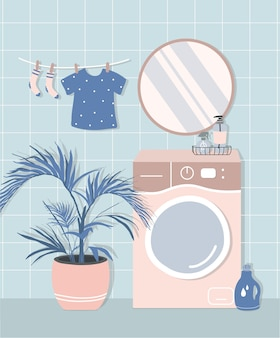 Intérieur de salle de bain élégant dans un style scandinave moderne. machine à laver, miroir, fleur, produits cosmétiques et de lavage. appartement confortable moderne et confortable.