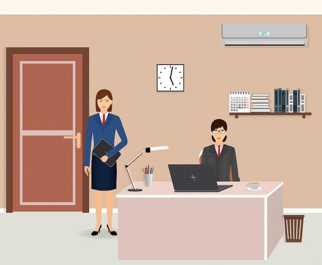Intérieur de la salle de bureau avec deux femmes.