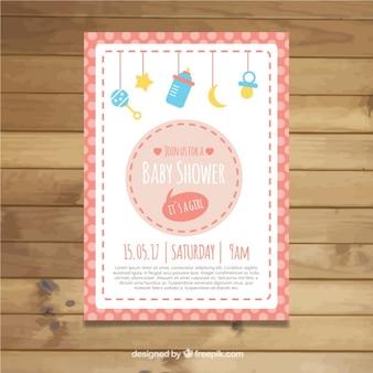 Invitation de douche de bébé avec des éléments suspendus et cadre dans les tons roses