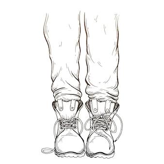 Jambes dans des pantalons et des bottes.