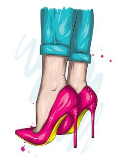 Jambes de femmes dans des chaussures élégantes à talons hauts.