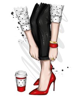 Jambes de femmes dans un pantalon élégant et des chaussures à talons hauts