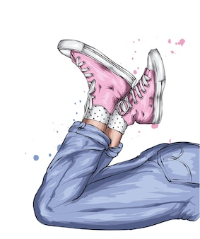Jambes en jeans et baskets élégants