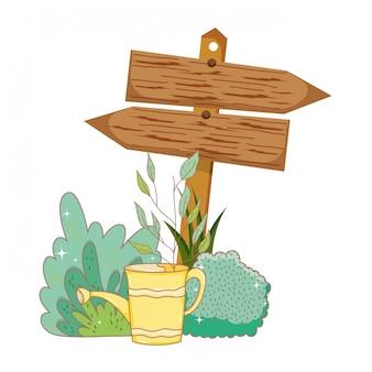 Jardin avec signal de flèche en bois