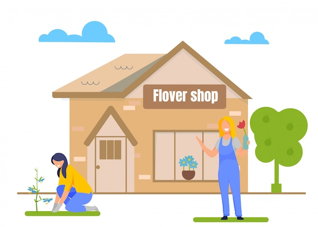 Jardiniers plantant des fleurs devant le magasin de fleurs