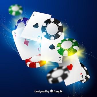 Jetons de casino réalistes et cartes tombant de fond