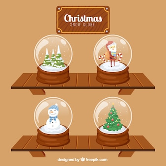 Jeu de boules de neige sur des étagères en bois