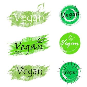 Jeu d'icônes végétaliennes bio ecology logos et badges biologiques étiquette feuille verte sur fond blanc