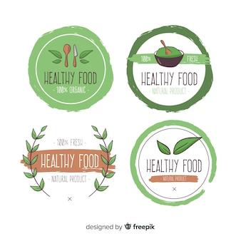 Jeu de logo d'aliments sains dessinés à la main