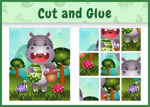 Jeu de société pour enfants découpé et collé sur le thème de pâques avec un joli hippopotame tenant l'oeuf de seau et l'oeuf de pâques