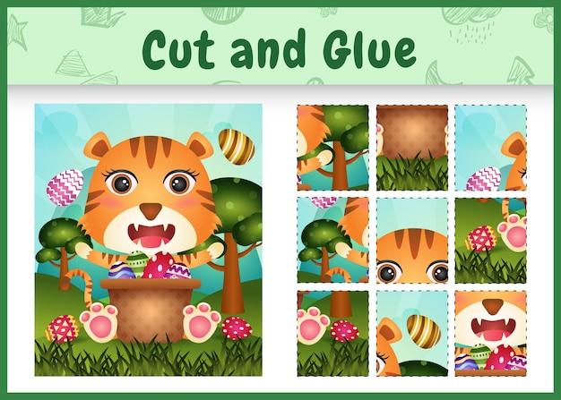 Jeu de société pour enfants découpé et collé sur le thème de pâques avec un joli tigre dans l'oeuf de seau