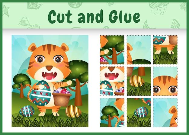 Jeu de société pour enfants découpé et collé sur le thème de pâques avec un tigre mignon tenant l'œuf de seau et l'œuf de pâques