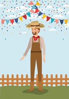 Jeune agriculteur fête avec guirlandes et clôture