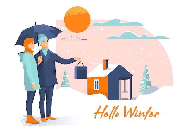 Jeune beau couple avec parapluie sur rue enneigée au jour