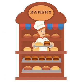 Jeune boulangère vendent beaucoup de pain dans la boulangerie