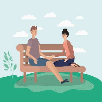 Jeune couple amoureux assis sur une chaise de parc
